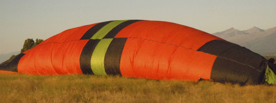 the 'LadyBug' hot-air balloon starting to inflate in the Bitterroot Valley of Western Montana, near Stevensville, Montana, south of Missoula.